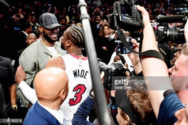 Lebron James of the Los Angeles Lakers greets Dwyane Wade of the Miami Heat prior to the game against the Brooklyn Nets at Barclays Center on April...
