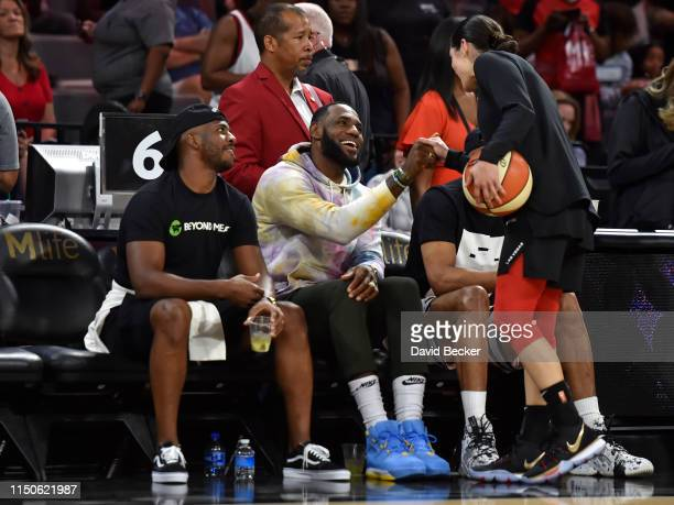 LeBron James of the Los Angeles Lakers greets Kelsey Plum of the Las Vegas Aces during the game against the New York Liberty on June 14 2019 at the...