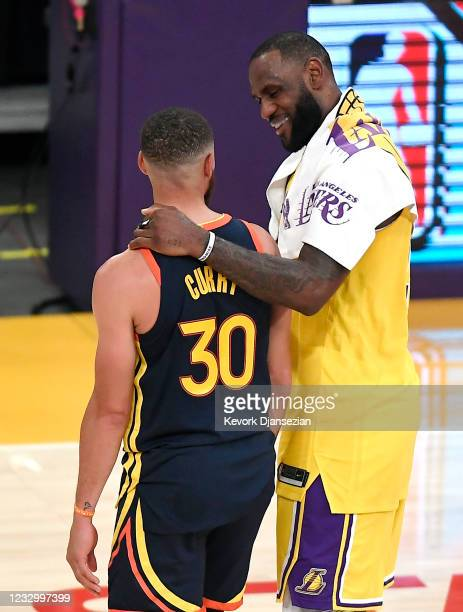 LeBron James of the Los Angeles Lakers greets Stephen Curry of the Golden State Warriors following the NBA Play-In Tournament at Staples Center on...