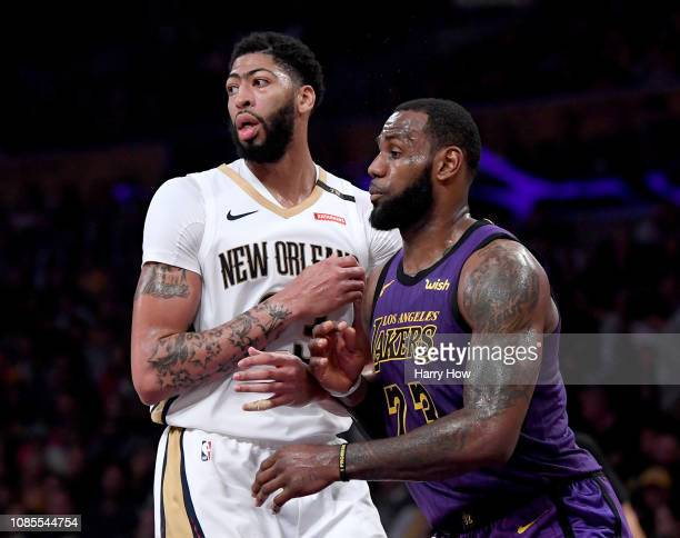 LeBron James of the Los Angeles Lakers guards Anthony Davis of the New Orleans Pelicans during a 112104 Laker win at Staples Center on December 21...