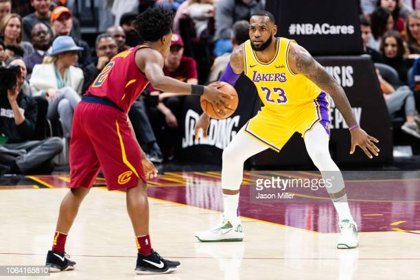 LeBron James of the Los Angeles Lakers guards Collin Sexton of the Cleveland Cavaliers during the first half at Quicken Loans Arena on November 21...