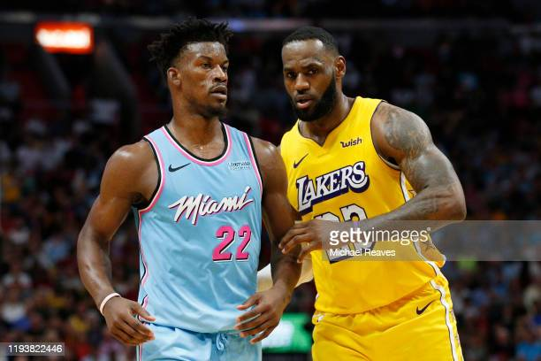 LeBron James of the Los Angeles Lakers guards Jimmy Butler of the Miami Heat during the second half at American Airlines Arena on December 13, 2019...