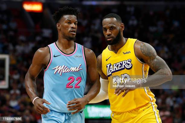 LeBron James of the Los Angeles Lakers guards Jimmy Butler of the Miami Heat during the second half at American Airlines Arena on December 13 2019 in...