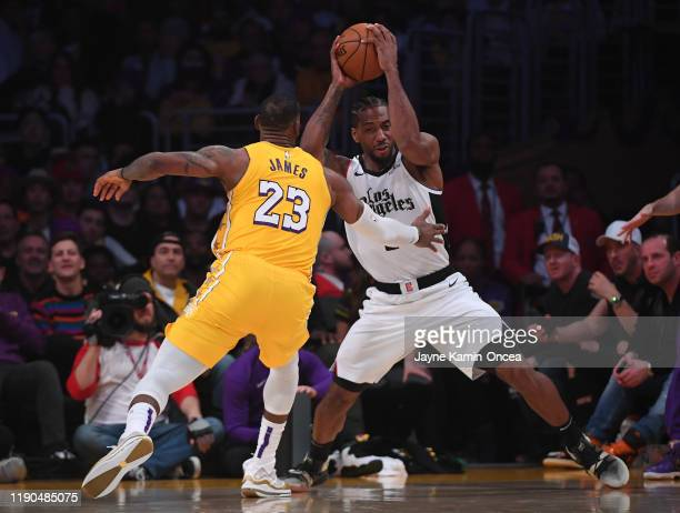 LeBron James of the Los Angeles Lakers guards Kawhi Leonard of the Los Angeles Clippers in the second half of the game at Staples Center on December...