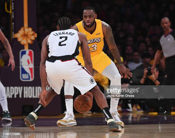 LeBron James of the Los Angeles Lakers guards Kawhi Leonard of the Los Angeles Clippers in the game at Staples Center on December 25, 2019 in Los...