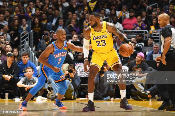 LeBron James of the Los Angeles Lakers handles the ball against Chris Paul of the Oklahoma City Thunder on November 19, 2019 at STAPLES Center in Los...