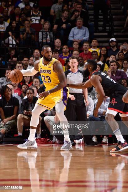 LeBron James of the Los Angeles Lakers handles the ball against James Harden of the Houston Rockets on December 13 2018 at the Toyota Center in...