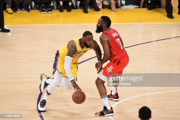 LeBron James of the Los Angeles Lakers handles the ball against James Harden of the Houston Rockets on February 21 2019 at STAPLES Center in Los...
