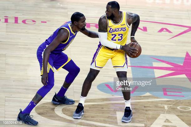 LeBron James of the Los Angeles Lakers handles the ball against Kevin Durant of the Golden State Warriors on October 10 2018 at TMobile Arena in Las...