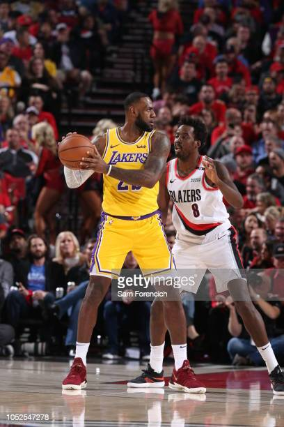 LeBron James of the Los Angeles Lakers handles the ball against AlFarouq Aminu of the Portland Trail Blazers on October 18 2018 at the Moda Center...