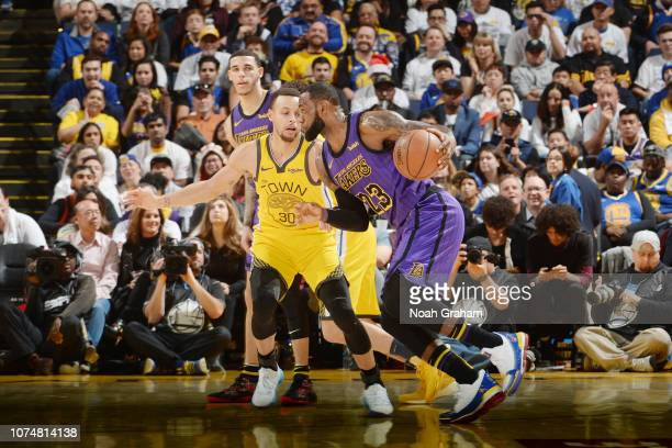 LeBron James of the Los Angeles Lakers handles the ball against Stephen Curry of the Golden State Warriors on December 25 2018 at ORACLE Arena in...