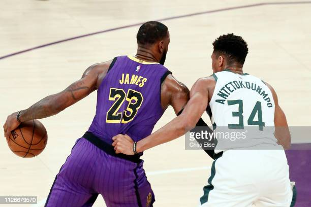 LeBron James of the Los Angeles Lakers handles the ball against Giannis Antetokounmpo of the Milwaukee Bucks on March 1 2019 at STAPLES Center in Los...