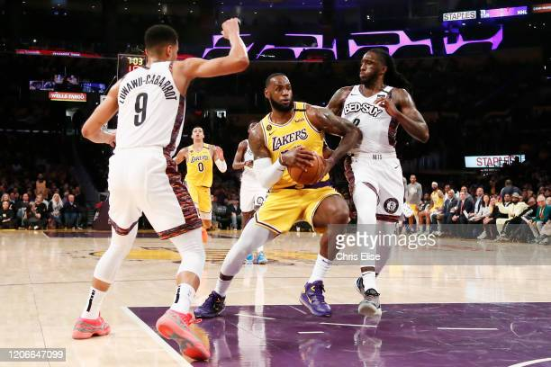 LeBron James of the Los Angeles Lakers handles the ball against Taurean Prince of the Brooklyn Nets during a game at the Staples Center on March 10...