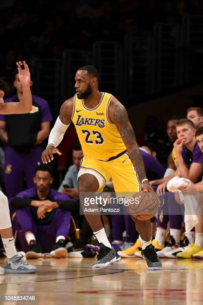 LeBron James of the Los Angeles Lakers handles the ball against the Sacramento Kings during a preseason game on October 4 2018 at Staples Center in...