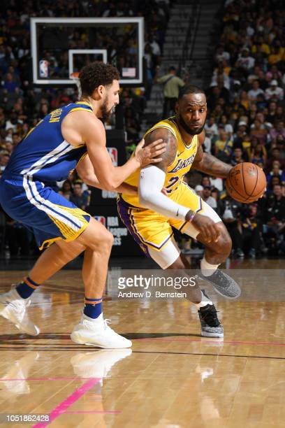 LeBron James of the Los Angeles Lakers handles the ball against the Golden State Warriors during a preseason game on October 10 2018 at TMobile Arena...