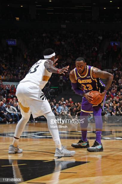 LeBron James of the Los Angeles Lakers handles the ball against the Toronto Raptors on March 14 2019 at the Scotiabank Arena in Toronto Ontario...