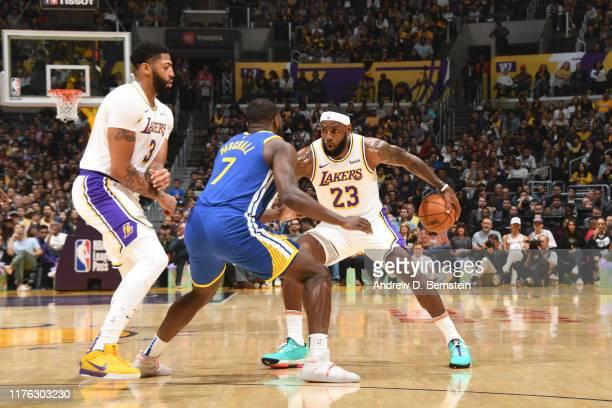 LeBron James of the Los Angeles Lakers handles the ball against the Golden State Warriors during a preseason game on October 16 2019 at STAPLES...