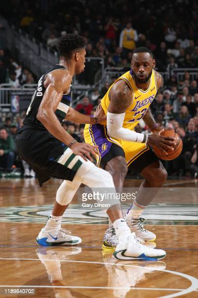 LeBron James of the Los Angeles Lakers handles the ball against the Milwaukee Bucks on December 19 2019 at the Fiserv Forum Center in Milwaukee...