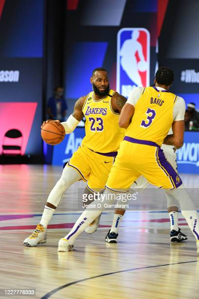 LeBron James of the Los Angeles Lakers handles the ball against the Orlando Magic during a scrimmage on July 25, 2020 at HP Field House at ESPN Wide...