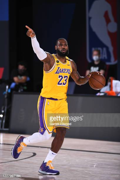LeBron James of the Los Angeles Lakers handles the ball against the Denver Nuggets on August 10 2020 at The AdventHealth Arena in Orlando Florida...