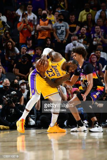 LeBron James of the Los Angeles Lakers handles the ball against the Phoenix Suns during Round 1, Game 2 of the 2021 NBA Playoffs on May 25, 2021 at...