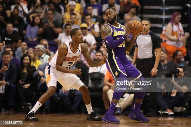 LeBron James of the Los Angeles Lakers handles the ball agianst Trevor Ariza of the Phoenix Suns during the second half of the NBA game at Talking...