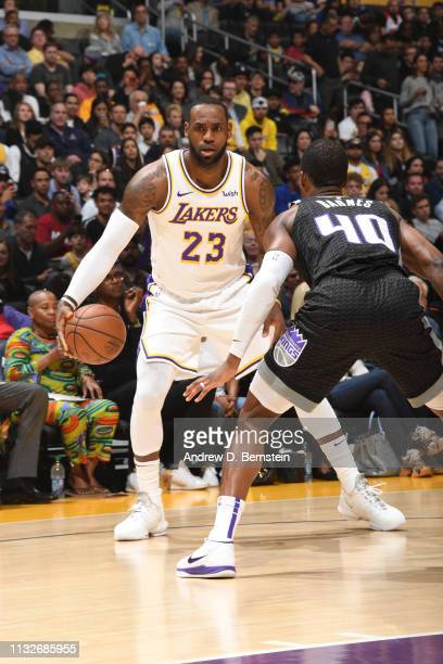LeBron James of the Los Angeles Lakers handles the ball during the game against Harrison Barnes of the Sacramento Kings on March 24 2019 at STAPLES...