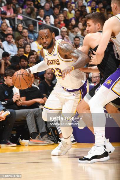 LeBron James of the Los Angeles Lakers handles the ball during the game against Bogdan Bogdanovic of the Sacramento Kings on March 24 2019 at STAPLES...
