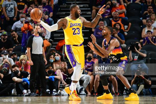 LeBron James of the Los Angeles Lakers handles the ball during the game against Mikal Bridges of the Phoenix Suns during Round 1, Game 2 of the 2021...