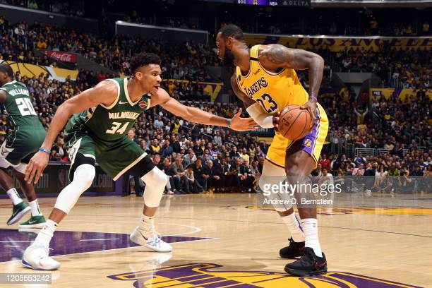 LeBron James of the Los Angeles Lakers handles the ball while Giannis Antetokounmpo of the Milwaukee Bucks plays defense during the game on March 6,...
