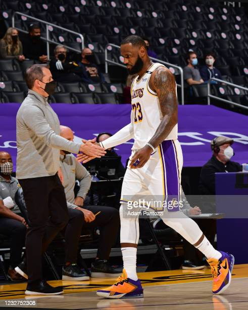 LeBron James of the Los Angeles Lakers high fives Head Coach Frank Vogel of the Los Angeles Lakers on May 2, 2021 at STAPLES Center in Los Angeles,...