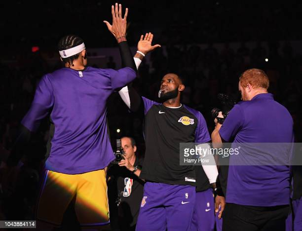 LeBron James of the Los Angeles Lakers high fives JaVale McGee as he is introduced before a preseason game against the Denver Nuggets at Valley View...