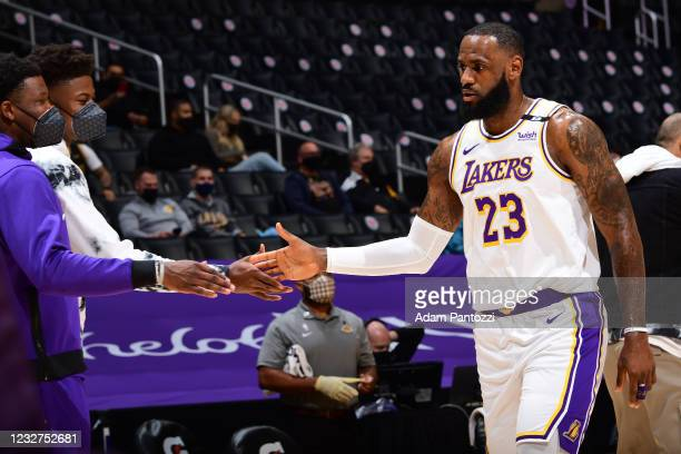 LeBron James of the Los Angeles Lakers high fives Kostas Antetokounmpo of the Los Angeles Lakers during the game against the Toronto Raptors on May...