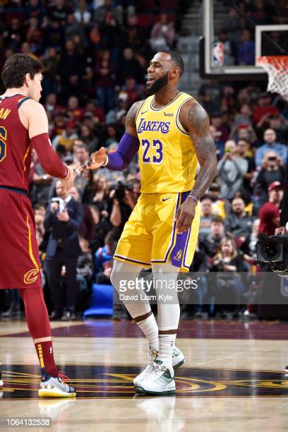 LeBron James of the Los Angeles Lakers high fives Kyle Korver of the Cleveland Cavaliers before the game on November 21 2018 at Quicken Loans Arena...