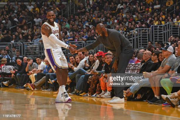 LeBron James of the Los Angeles Lakers high fives NBA Legend Kobe Bryant during the game against the Atlanta Hawks on November 17 2019 at STAPLES...