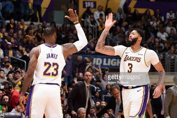 LeBron James of the Los Angeles Lakers high fives teammate Anthony Davis during the game against the Minnesota Timberwolves on December 8 2019 at...