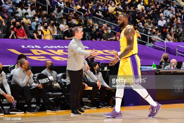 LeBron James of the Los Angeles Lakers high-fives Head Coach Frank Vogel during the game against the Phoenix Suns during Round 1, Game 3 of the 2021...