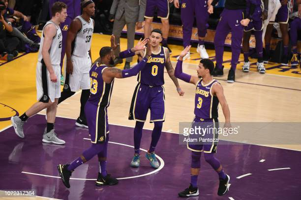 LeBron James of the Los Angeles Lakers highfives Kyle Kuzma of the Los Angeles Lakers and Josh Hart of the Los Angeles Lakers against the San Antonio...