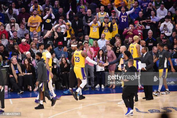LeBron James of the Los Angeles Lakers highfives teammates after passing Kobe Bryant for third on NBA's alltime scoring list on January 25 2020 at...