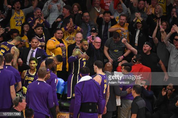 LeBron James of the Los Angeles Lakers highfives teammates in huddle against the San Antonio Spurs on December 5 2018 at STAPLES Center in Los...