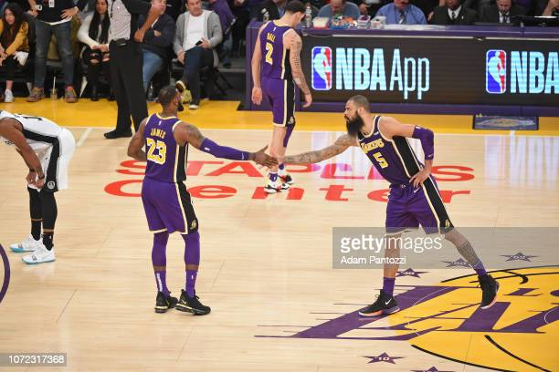 LeBron James of the Los Angeles Lakers highfives Tyson Chandler of the Los Angeles Lakers against the San Antonio Spurs on December 5 2018 at STAPLES...