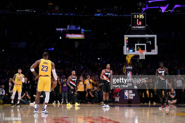 LeBron James of the Los Angeles Lakers holds the ball for a 24 second shot clock violation to honor Kobe Bryant during the game against the Portland...