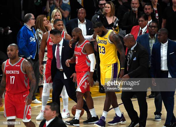 LeBron James of the Los Angeles Lakers hugs Chris Paul of the Houston Rockets after he was ejected for fighting during the second half of a...