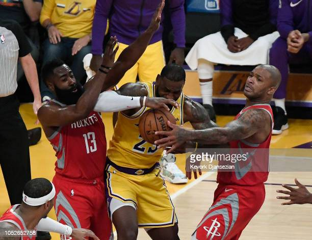 LeBron James of the Los Angeles Lakers is defended by James Harden and PJ Tucker of the Houston Rockets at Staples Center on October 20 2018 in Los...
