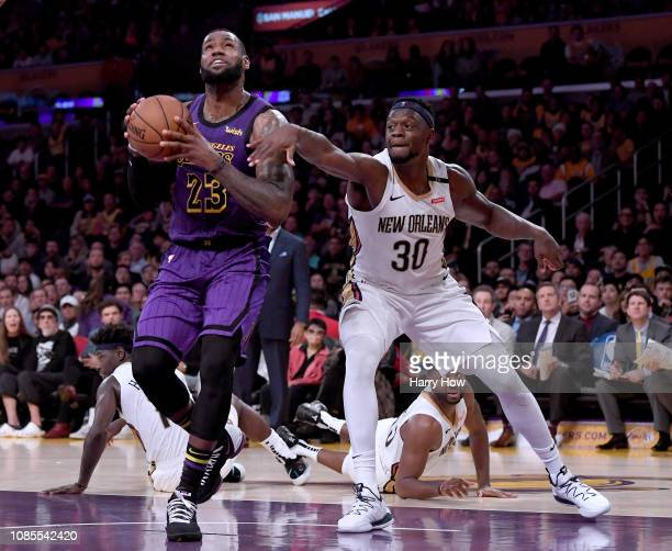 LeBron James of the Los Angeles Lakers is fouled by Julius Randle of the New Orleans Pelicans during a 112104 Laker win at Staples Center on December...