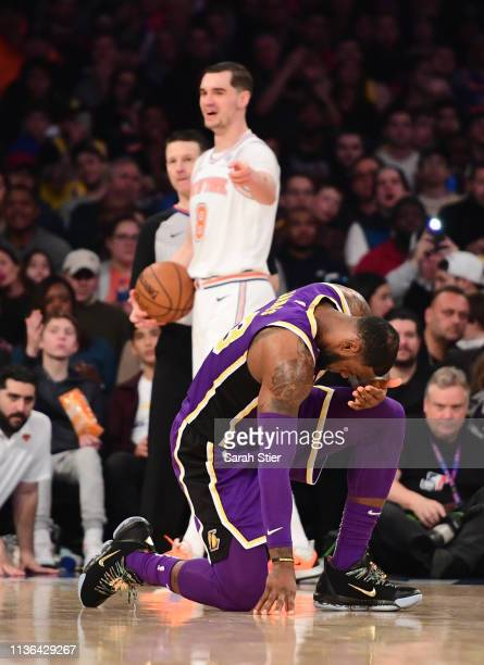 LeBron James of the Los Angeles Lakers is fouled by Mario Hezonja of the New York Knicks during the second half of the game at Madison Square Garden...