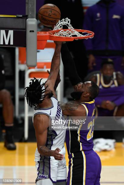 LeBron James of the Los Angeles Lakers is fouled by Marvin Bagley III of the Sacramento Kings as he goes up for a layup during the first half at...
