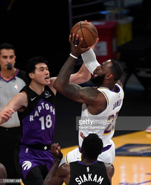 LeBron James of the Los Angeles Lakers is fouled by Yuta Watanabe of the Toronto Raptors during the first half at Staples Center on May 2, 2021 in...