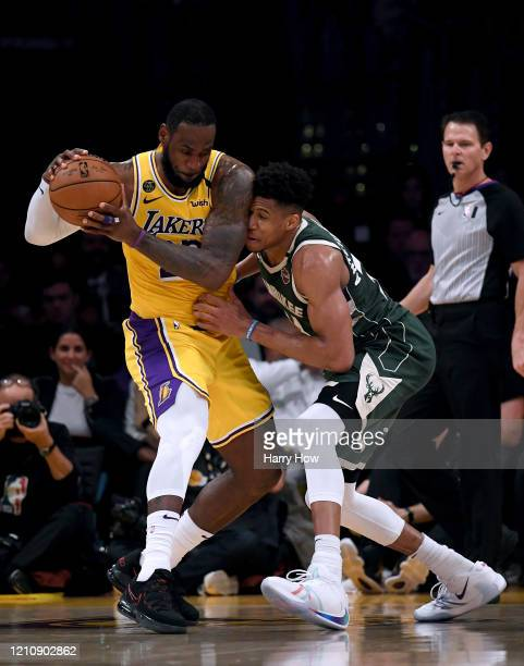 LeBron James of the Los Angeles Lakers is guarded by Giannis Antetokounmpo of the Milwaukee Bucks during the third quarter at Staples Center on March...