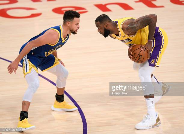 LeBron James of the Los Angeles Lakers is guarded by Stephen Curry of the Golden State Warriors during the first half at Staples Center on January...